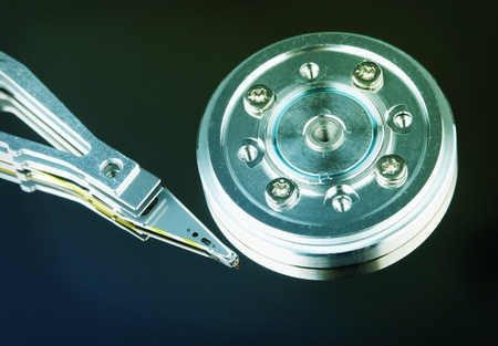 microscopical: Spindle and magnetic head of a computer hard disk Stock Photo