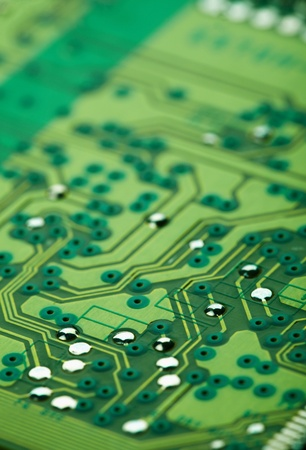 microscopical: Abstract electronic background - the green printed-circuit board