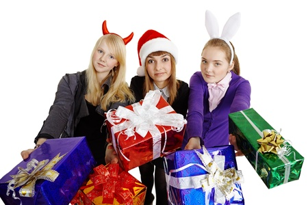 Three girls hand over New Years gifts isolated on a white background photo