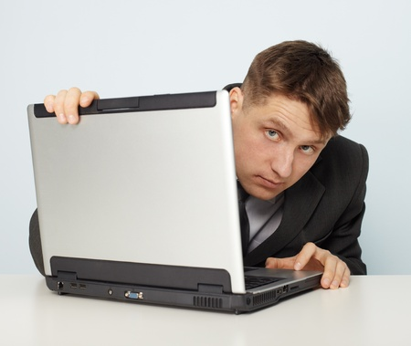 A man in a business suit looks illegal sites Stock Photo - 8423845