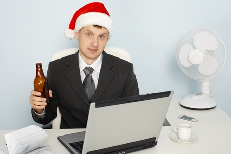 Businessman meets the new year still working in office photo