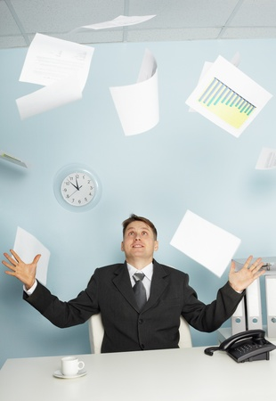 juggling: Bureaucrat - a businessman juggling documents as a magician
