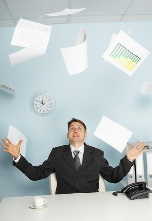 Bureaucrat - a businessman juggling documents as a magician Stock Photo - 8432880