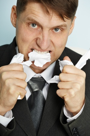 spiteful: The angered manager tears teeth documents - a close up
