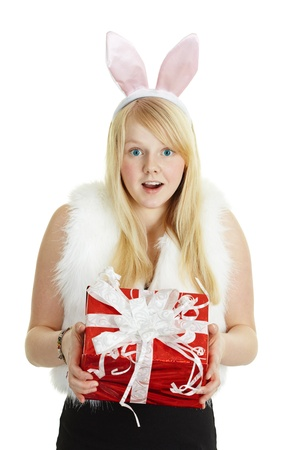 Happy smiling girl with a gift in a rabbit costume isolated on white background Stock Photo - 8432884