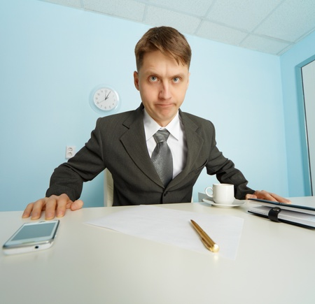 wrathful: Angry boss looks at the slave sitting at the table Stock Photo