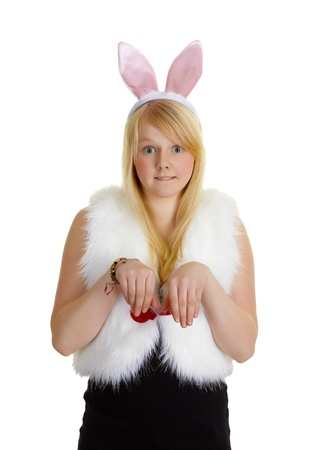 Funny young girl with a pink rabbit ears isolated on white photo