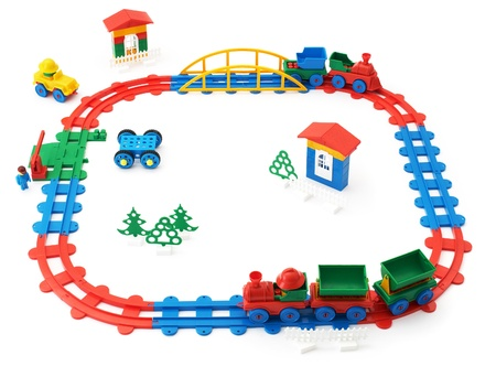The childrens railway, trains and other toys on a white background photo