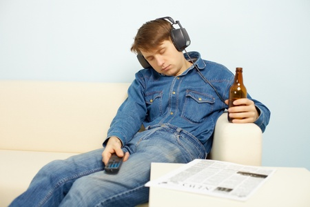 in somnolence: Young people traditionally relaxing at home after work Stock Photo