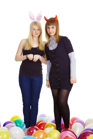 two attractive girls in the costumes of the hare and the devil. White background  photo