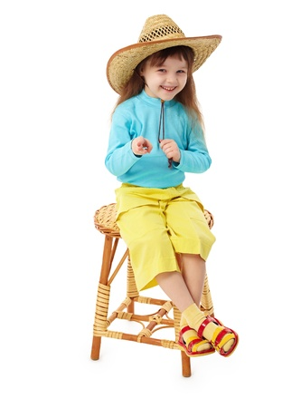 the stool: The little girl in a straw hat sitting on an old-fashioned wooden chair