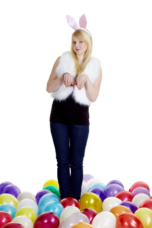 girl dressed as a rabbit and balloons on a white background  photo