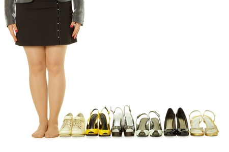 several: barefoot woman and lots of shoes on white