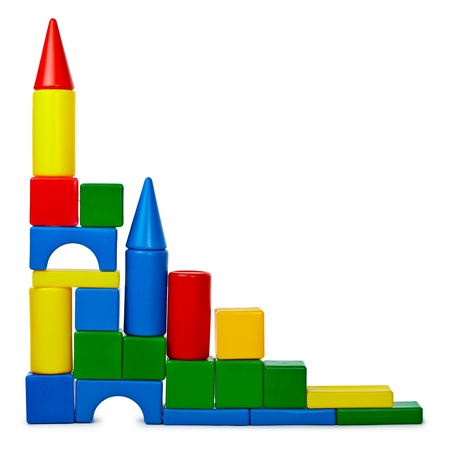plastic bricks: The castle was built from colored plastic bricks isolated on white background