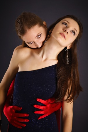 sacrifices: Two young girls portrayed the vampire and his sacrifice on dark background