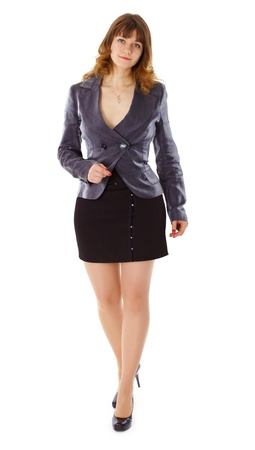 A beautiful young woman in a business suit isolated on white background photo