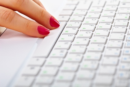 Ladies fingers on a white keyboard of laptop photo