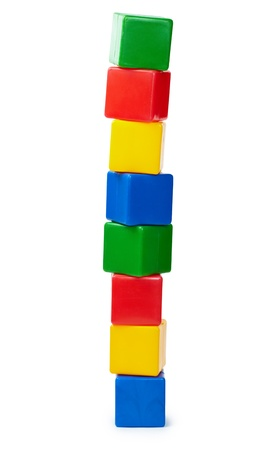 yellow block: Tower of colored cubes toy isolated on white background