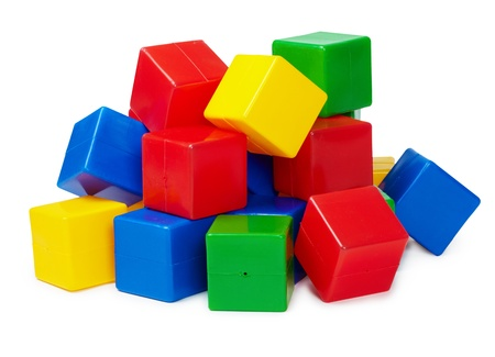 Pile of colored toy blocks isolated on white background photo