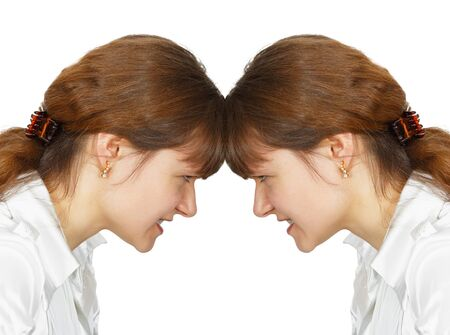 A woman facing her forehead with herself isolated on white background photo