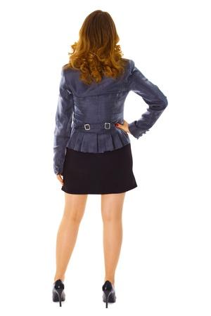 loose hair: Azienda giovane donna - vista posteriore isolato su sfondo bianco