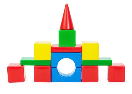 Toy castle of colored plastic blocks isolated on white background photo