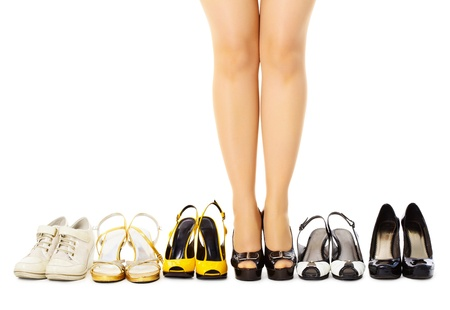 Large selection of womens shoes for different weather, isolated on white background photo
