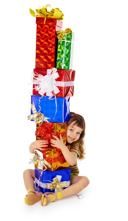 A little girl hugs birthday gifts, isolated on a white background photo