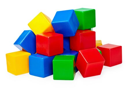 yellow block: A small handful of childrens toy blocks on a white background