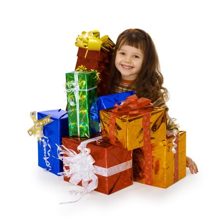 The happy child and the big heap of gifts on birthday Stock Photo - 9402243