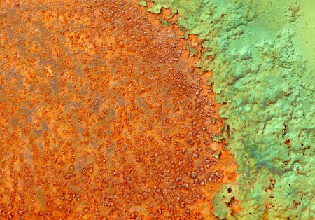 Partially rotted paint on the metal rusty surface Stock Photo - 9486604