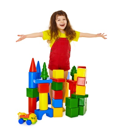 rejoices: Happy child in a toy castle isolated on white background