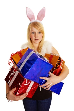 A young blonde in a bunny suit with a bunch of gifts isolated on white background photo