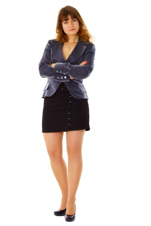 stern: Young serious woman in a business suit isolated on white background