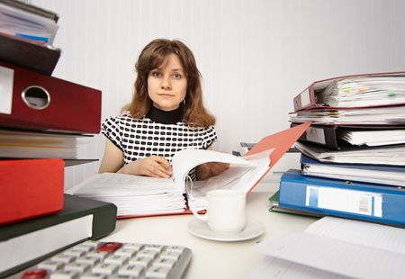 Female accountant very busy working in the office photo