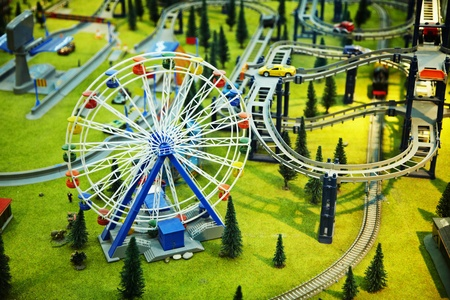 maquette: Miniature model - a park with a Ferris wheel and the railway