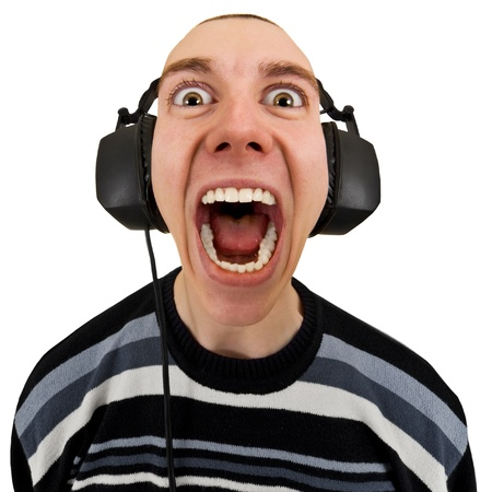 headset voice: Funny man in the stereo headphones shouting isolated on a white background Stock Photo