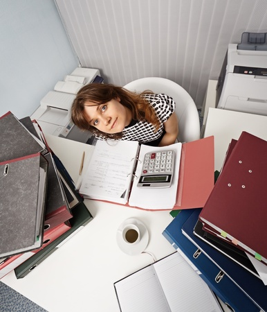 financier: A young woman - a financier on workplace in the office Stock Photo