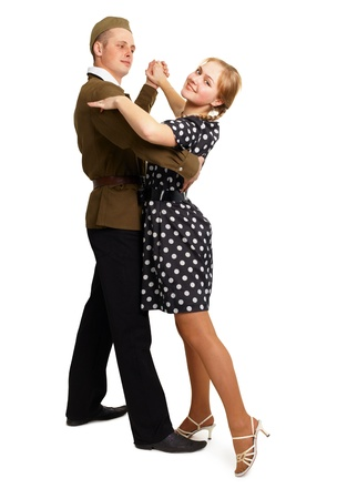 Dancing couple dressed in 60s isolated on white background Stock Photo