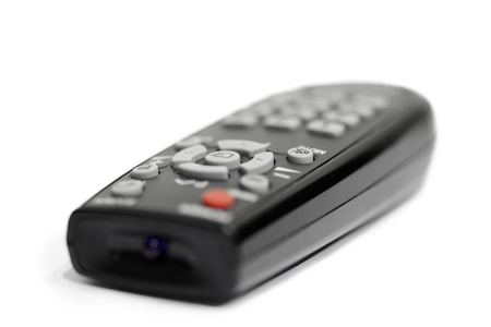 Black remote control isolated on white background photo