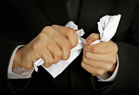 shred: Businessman hands furiously tormenting document close up Stock Photo