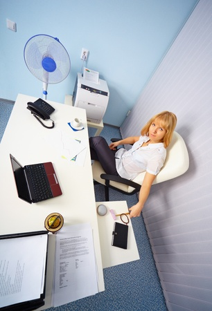 A pretty young secretary on workplace in the office photo