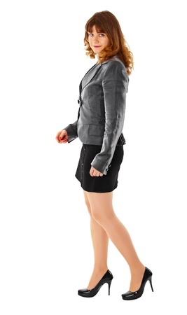 A young girl dressed in business clothing on a white background photo