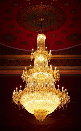 crystal chandelier: The huge old antique chandelier from the ceiling of a Buddhist temple
