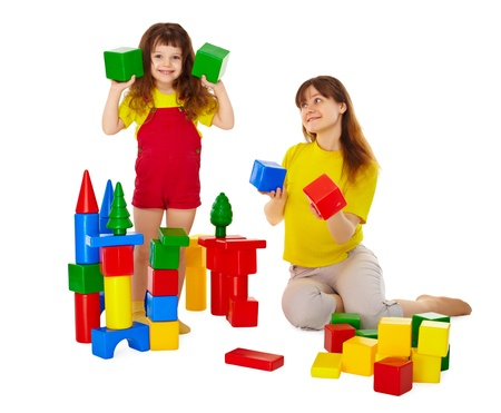 Mom and daughter playing with blocks isolated on white background photo