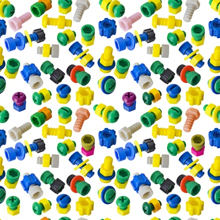 Seamless texture - color toy nuts and bolts on white photo