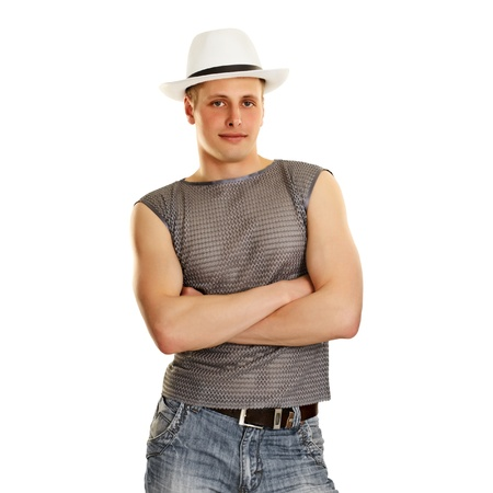 A young man in a T-shirt, jeans and a hat isolated on white background photo