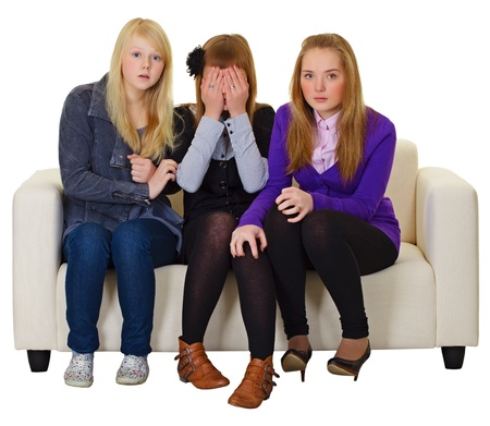 The three girls look a horror movie on the couch Stock Photo - 11052227