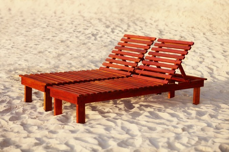 sunbed: The beach belongs to relax - wooden sunbed Stock Photo