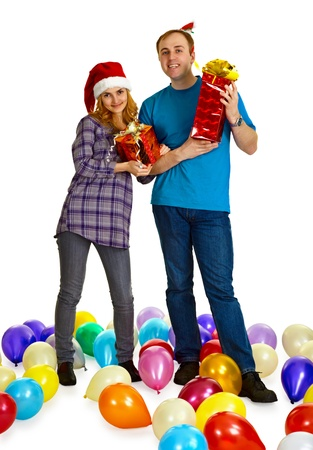 a married couple with christmas gifts isolated on white background stock photo 11052243